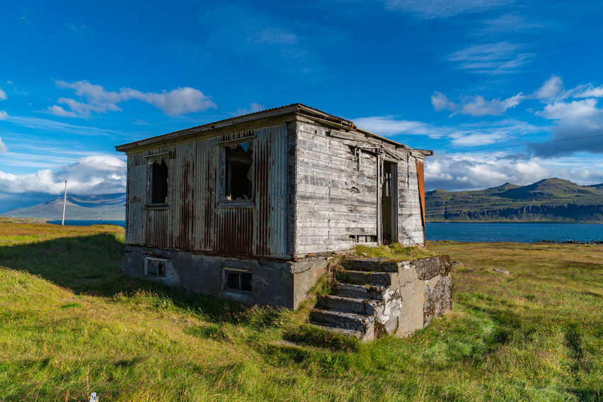 Iceland Abandoned Architecture Beautifuliceland Blue Built Structure Cloud - Sky Day Environment Field Grass Land Nature No People Old Outdoors Plant Sky Sunlight Tranquility Water