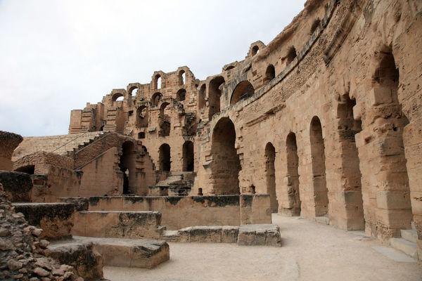 The amphitheater in El Jem, Tunisia Africa Amphitheater Ancient Arches Architecture Arena Building Exterior Built Structure El_jem Empire Erosion Gladiator, Heritage Historic History Landmark Old Roman Ruined Stone Stone Material Stone Wall Tunisia Unesco