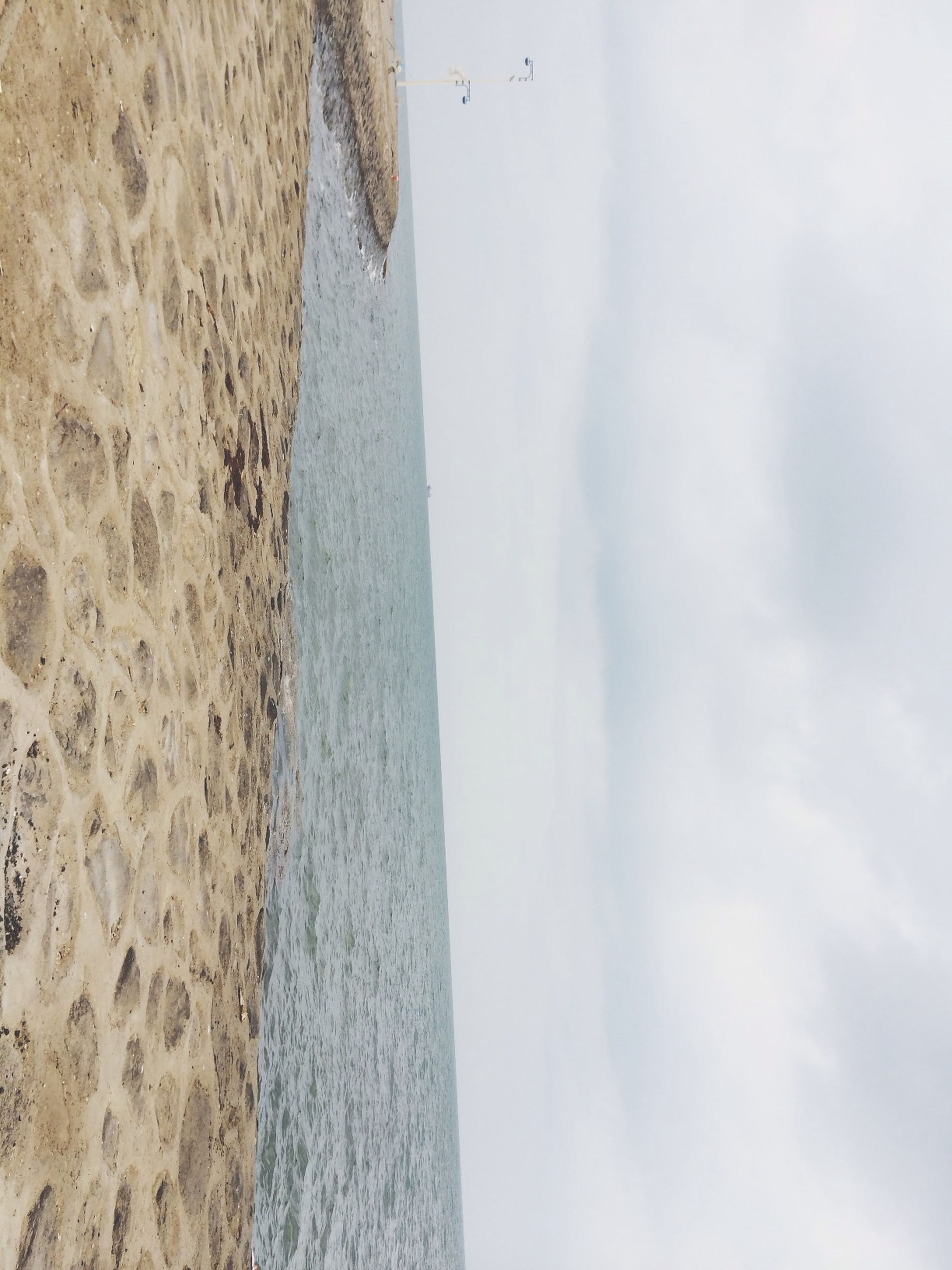 sea, horizon over water, water, beach, sky, tranquil scene, tranquility, scenics, shore, beauty in nature, sand, nature, cloud - sky, idyllic, remote, day, coastline, cloud, cloudy, outdoors