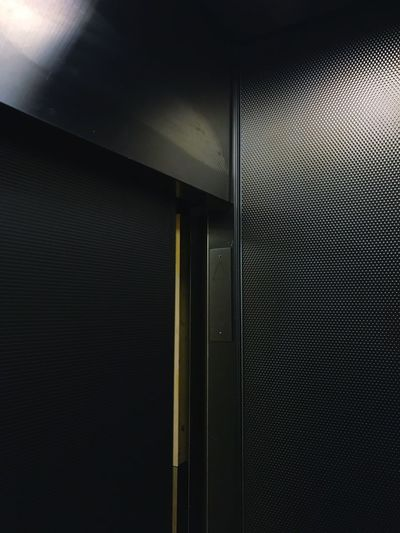 Indoors  No People Illuminated Built Structure Close-up Day Elevator Darkness And Light Apartment Building Gray Structure Pattern Yellow
