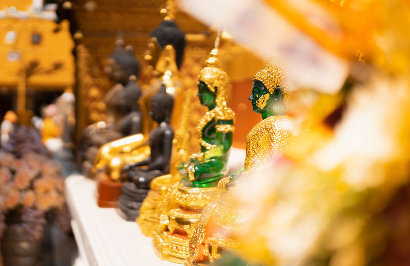 jade buddha statue whith blurred golden tone background, selective focus, buddhist holy day concept Asian  Bright Buddha Buddhism Buddhist Ceremony Culture Day Focus Golden Holy Jade Monk  Pagoda Religion Selective Statue Symbol Temple Thai Thailand Yellow