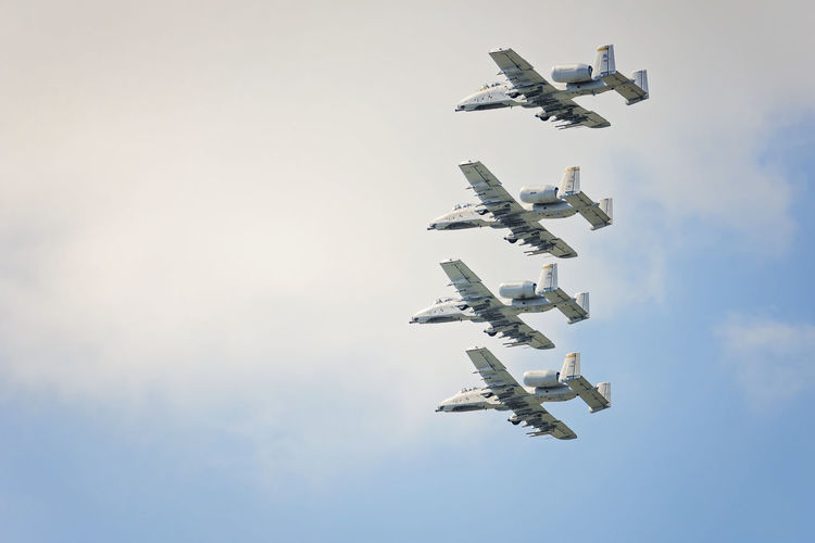 Low angle view of military airplanes performing in sky