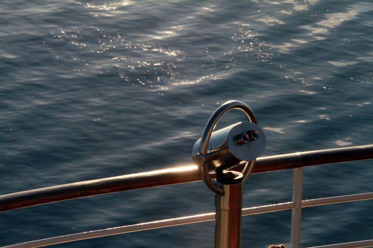 Close-up of sailboat sailing in sea