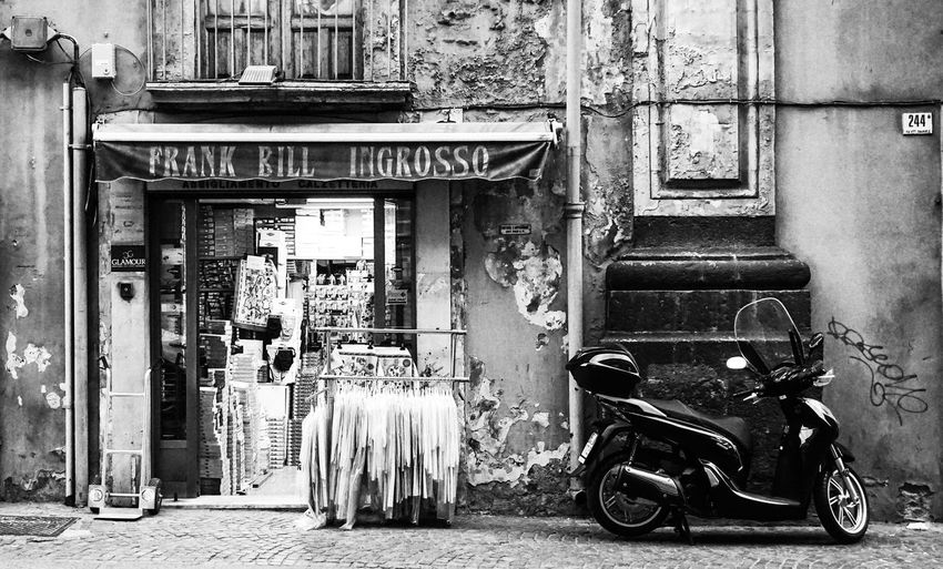 old facade in Catania, Sicily, Italy Architecture Built Structure City Scooter No People Black And White Old Town Street Photography Streetphotography Textile Abandoned