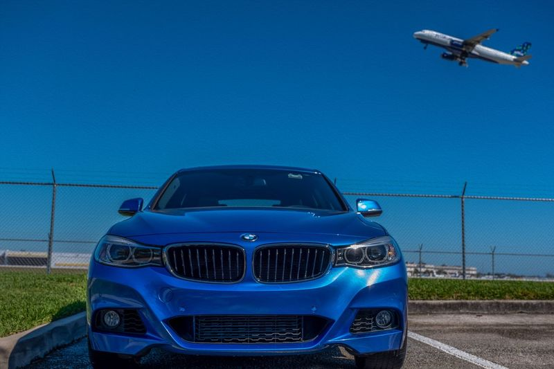 Jet Blue Photographyisthemuse Mode Of Transport Car Blue Bmw Airplane Automobile Air Vehicle Motor Vehicle Sky Clear Sky Land Vehicle No People Outdoors Airport Front View Travel Day