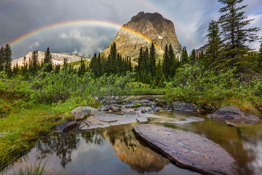 What's over the multiple rainbows | While the light drizzle endured, suddenly a double rainbow appeared before the protruding Pharaoh Peak and Scarab Peak (left). This rainbow was actually one of the rare 'supernumerary rainbows.' Another faint bow accompanied right underneath the main bow. The reflected rainbow in the creek was also delightful. Banff NP, Alberta, Canada Adventure Alberta Backcountry Backpacking Banff  Banff National Park  Cloud - Sky Clouds Double Rainbow Egypt Lake Campground Mountain Mountain Range Nature Non-urban Scene Outdoors Pharaoh Creek Pharaoh Peak Rainbow Reflections Scarab Peak Storm Cloud Supernumerary Rainbow Tranquility Water Wilderness