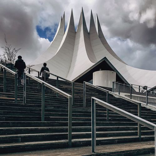 Low Angle View Of Men Walking On Steps At Tempodrom Berlin