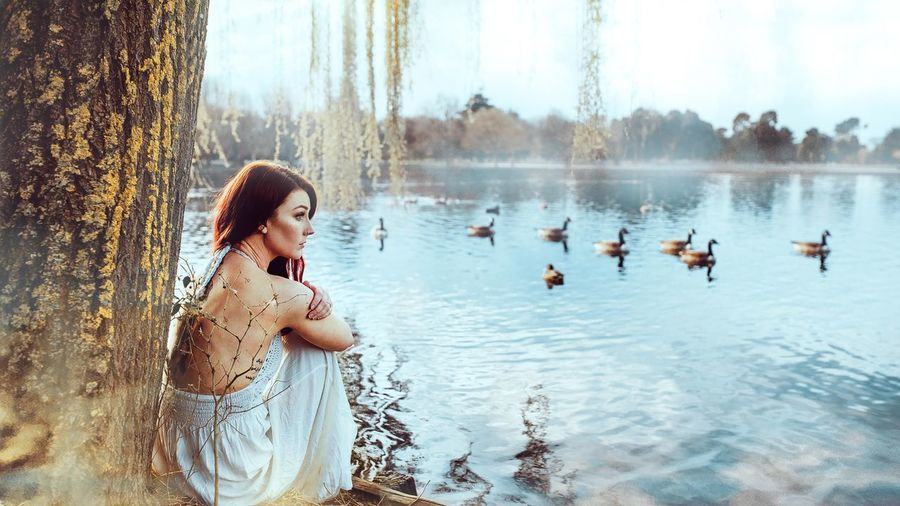 Side view of young woman in lake