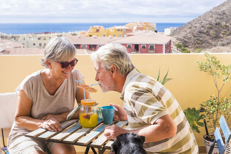 Senior couple enjoying wine at outdoors restaurant