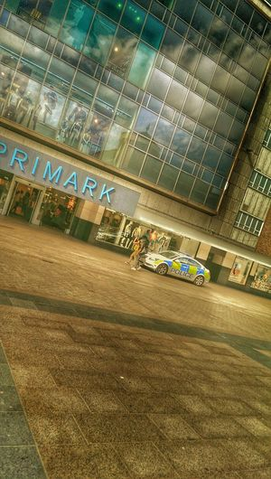 Police Colours Glass Reflection Sky Reflections Shopping City Life High Street Shopping Streetphotography Large Windows