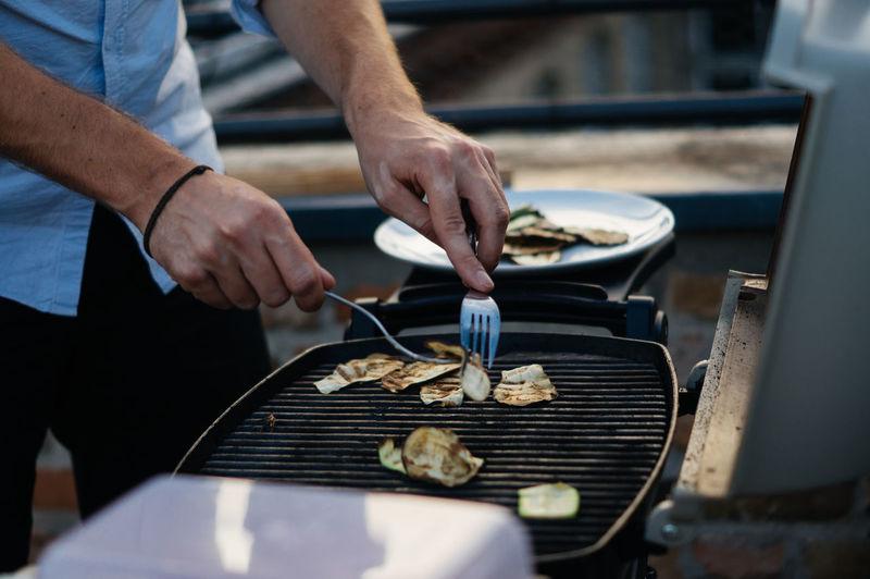 Man preparing grilled vegetables