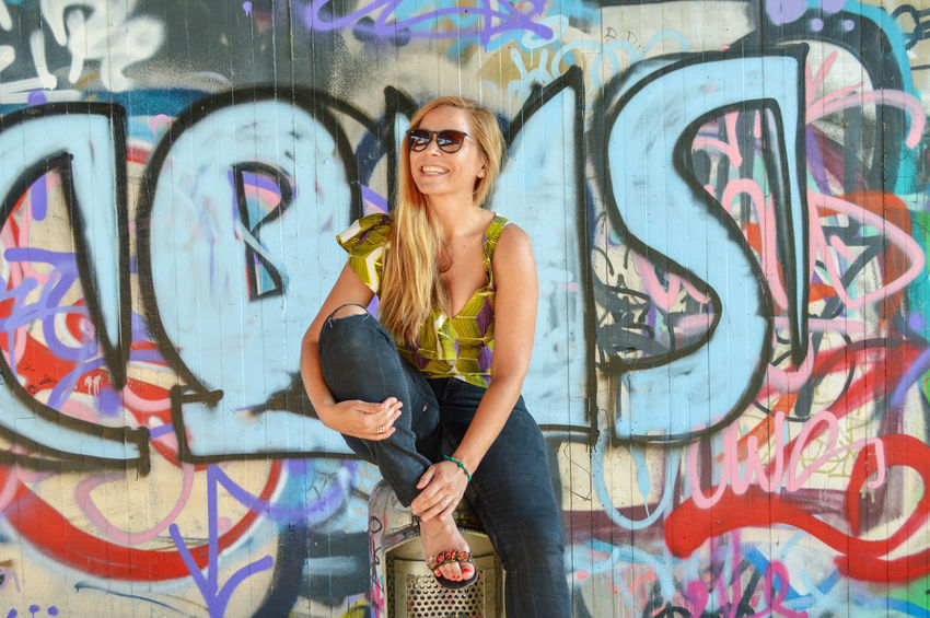 Portrait Of A Woman Urban Urban Scene Urbanphotography Street Art Streetphotography Contrasting Colors Colourful Young Women Portrait Beautiful Woman Multi Colored Looking At Camera Artist Full Length Street Art Spray Paint Mural Graffiti Paintings Modern Art Urban Fashion Jungle