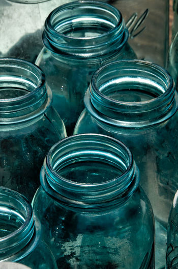 Jar Container Glass - Material No People Indoors  Close-up Blue Still Life Bottle High Angle View Transparent Table Focus On Foreground Group Of Objects Metal Mason Jar Medium Group Of Objects Nature Factory