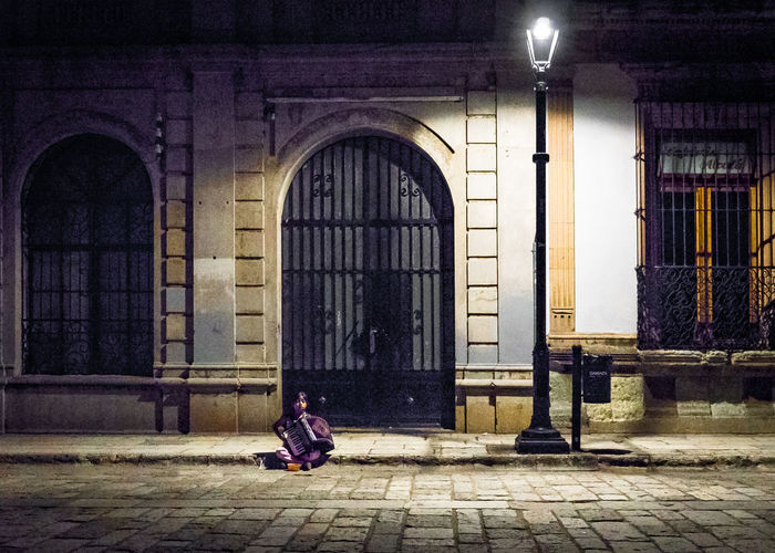 Arch Architecture Building Building Exterior Built Structure Door Entrance Illuminated Musician Night One Person Social Issues Street Streetphotography Tourism