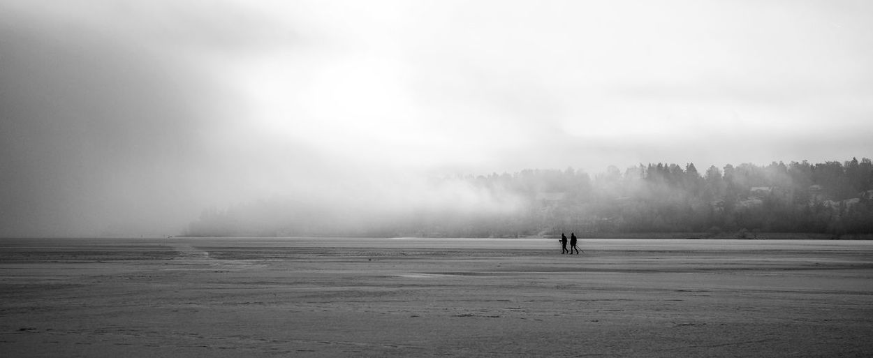 Silhouette People On Land During Foggy Weather