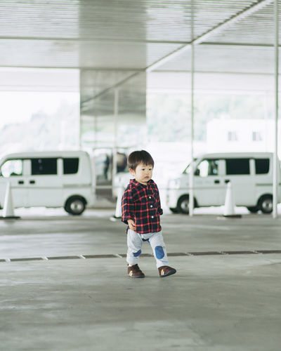 Childhood Child Males  One Person Boys Full Length Transportation Real People Men Car Casual Clothing Motor Vehicle Cute Innocence Day Standing Mode Of Transportation Land Vehicle Looking Outdoors Mouth Open