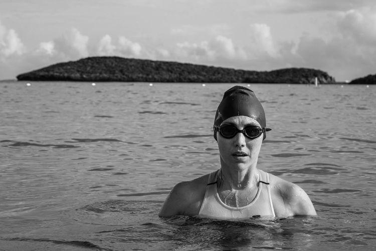Portrait of triathlete woman swimming at beach.