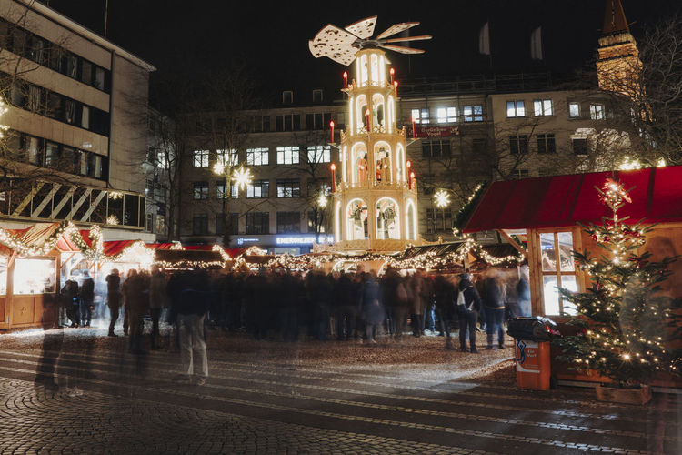 Christmas Market Germany Christmas Christmas Market Christmas Decoration Christmas Lights Illuminated Architecture Night Building Exterior City Built Structure Street Group Of People Building Reflection Lighting Equipment Transportation Travel Destinations Outdoors City Life Motion Road Tree Water