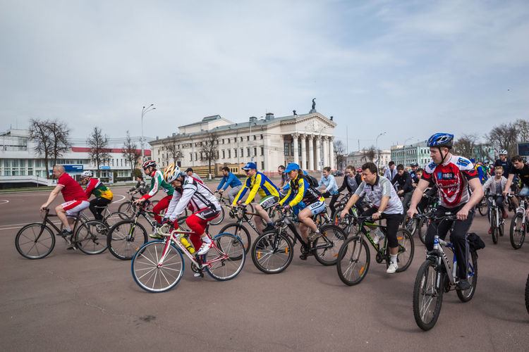 Gomel, Belarus - April 10, 2016: Bicyclists begin movement in honor of the bicycle season in 2016 on Lenin Square Athlete Belarus Gomel Lenin Square Sportsman Woman Architecture Bicycle Bike Day Editorial  Famele Land Vehicle Men Meny Outdoors Real People Ride Riders Season  Sky Sport Start Transportation Young Adult