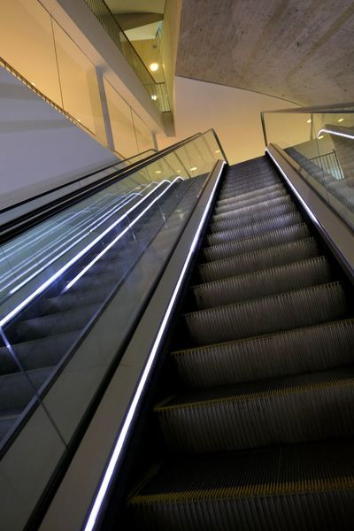 Indoors  Railing Escalator Architecture Staircase Steps And Staircases Convenience Illuminated Technology The Way Forward Low Angle View Direction Modern No People Metal Lighting Equipment Diminishing Perspective Futuristic