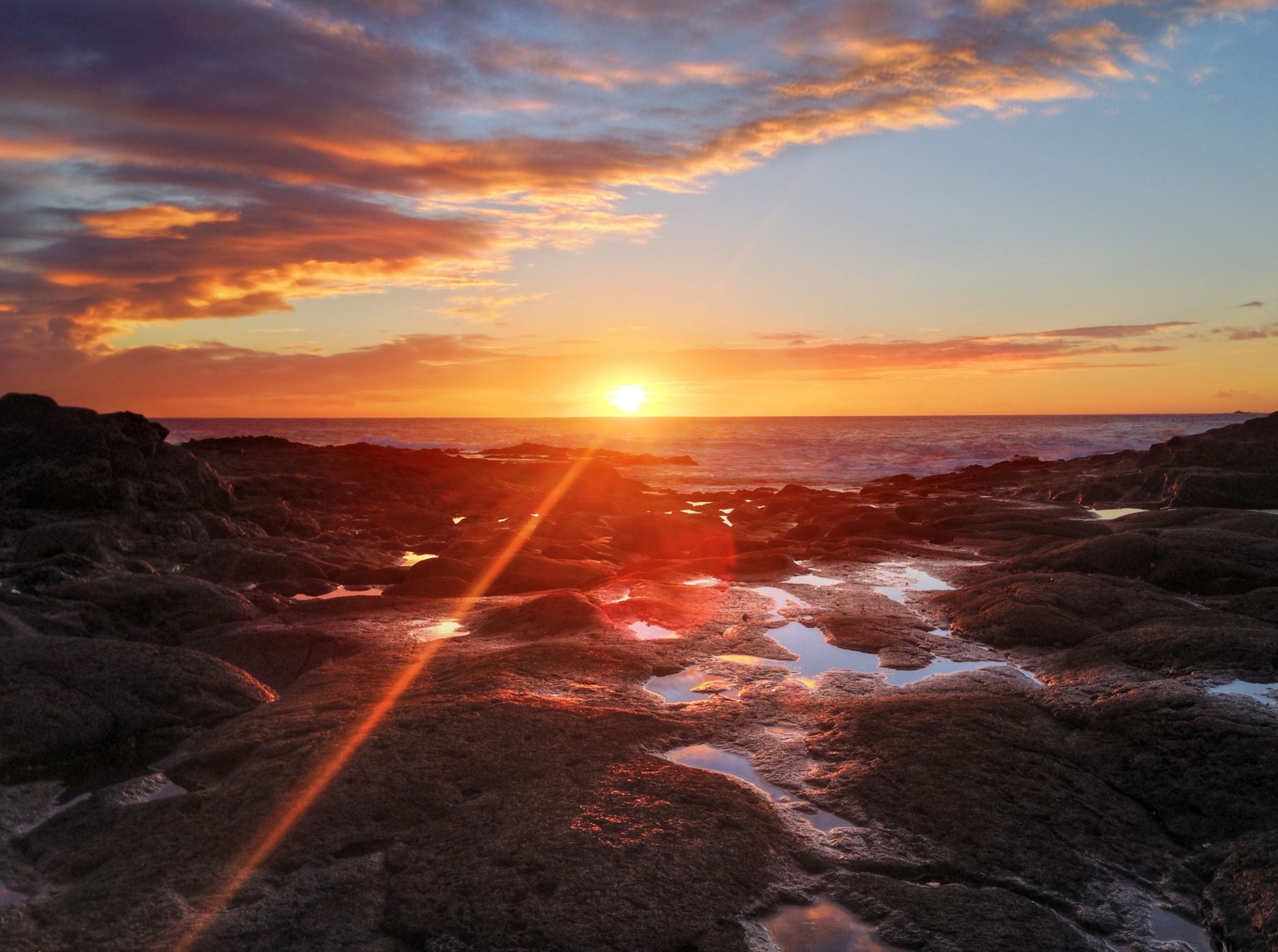 sunset, sun, sea, sky, water, scenics, beauty in nature, beach, tranquil scene, orange color, tranquility, horizon over water, cloud - sky, sunbeam, nature, shore, lens flare, sunlight, idyllic, rock - object