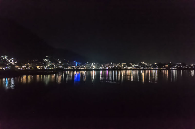 Photograph of Pokhara, Kathmandu City Nepal at night after massive Earth in landscape and wide screen is adventure, inspiration, exhilarating, hopeful, bright, and Travel Vacation security, freedom, simplicity Holiday be used as backgrounds. EyeEmNewHere Travel Tourism Nice Looking For Inspiration Looking Looking Down Young Adult Communication Young Women Arts Culture And Entertainment Architecture Beauty In Nature Building Building Exterior Built Structure City Copy Space Illuminated Lake Nature Night No People Outdoors Reflection Sky Tranquility Travel Tourism Industry Scenic Beauty Holiday Vacation Concept Water Waterfront #urbanana: The Urban Playground