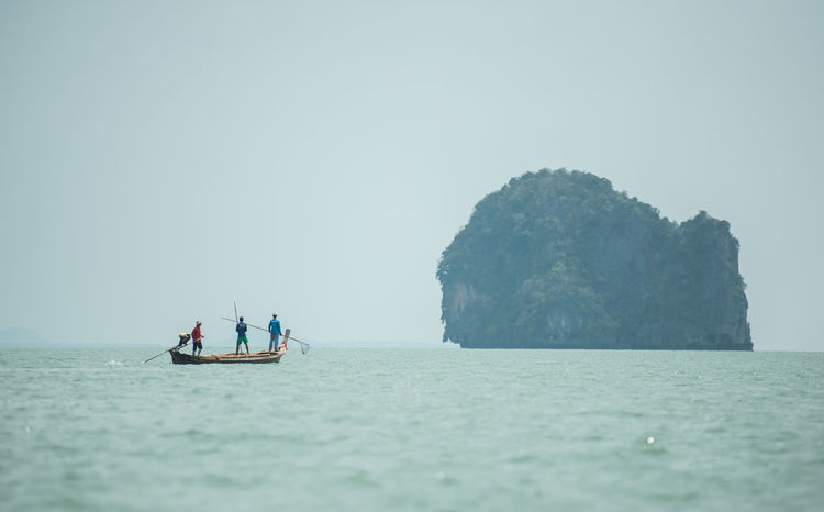 Fisherman, Phang-Nga, Thailand Adult Adults Only Blue Clear Sky Day Men Nature Nautical Vessel Only Men Outdoors People Rock - Object Sea Sky Tranquility Water