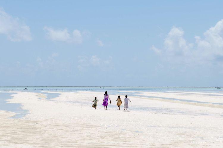 Low tide Tanzania This Is Africa Africa EyeEmNewHere Sea Beach Land Water Sky Real People Cloud - Sky The Week On EyeEm Editor's Picks