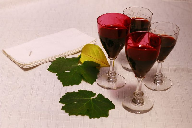 Wine Moments Red Wineglass Wine Drink Drinking Glass Close-up Indoors  For Rest Alcohol Vine Leaves White Tablecloth Yellow Lemon Leaf White Napkin