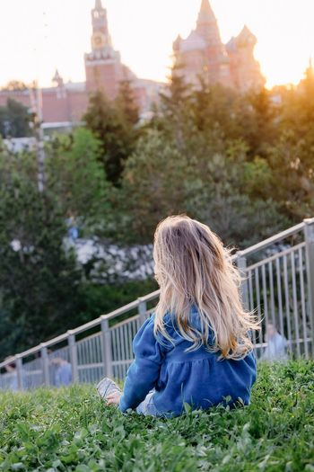 Hair Blond Hair Plant One Person Hairstyle Rear View Architecture Women Nature Long Hair Tree Railing Casual Clothing Day Built Structure Sky Females Outdoors Kid Young Sunshine Sunset Sunrise Travel Garden Park