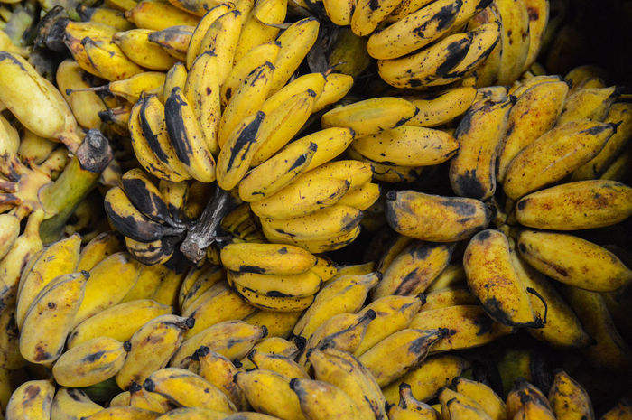 Bananas For Sale Bananas Yellow Freshness Market Full Frame Abundance Retail  No People Outdoors Day Healthy Eating Backgrounds Food Nature Close-up Beauty In Nature Texture