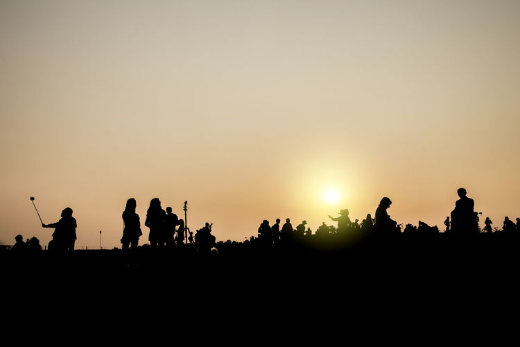 Silhouette of Tourist Adults Only Outdoors People Selfie Silhouette Sunset Tourist Travel