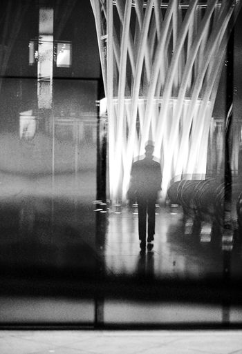 - Walking Reflection (3) Streetphotography EyeEm Best Shots - Black + White Travcimages Visual Creativity Nycphotographer FUJIFILM X-T2 eyeemphoto EyeEm Gallery Reflection Popular Photos Shadowplay Blackandwhite Photography Architecture Real People Built Structure Indoors  Walking One Person Pattern The Street Photographer - 2018 EyeEm Awards