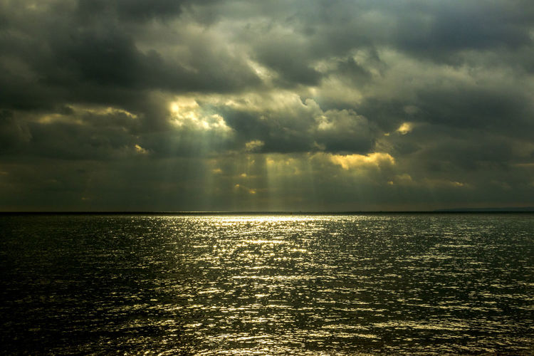 Stormy seaview Awe Beauty In Nature Cloud - Sky Dramatic Sky Horizon Over Water Idyllic Majestic Nature No People Outdoors Reflection Rippled Scenics Sea Sky Storm Cloud Sun Sunbeam Sunlight Sunset Tranquil Scene Tranquility Water Waterfront Weather