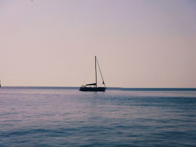 Water Sea Sunset Nautical Vessel Clear Sky Beauty In Nature Transportation Waterfront Outdoors Mode Of Transport Nature Sailing No People Horizon Over Water Tranquil Scene Sky Sailboat Mast Scenery