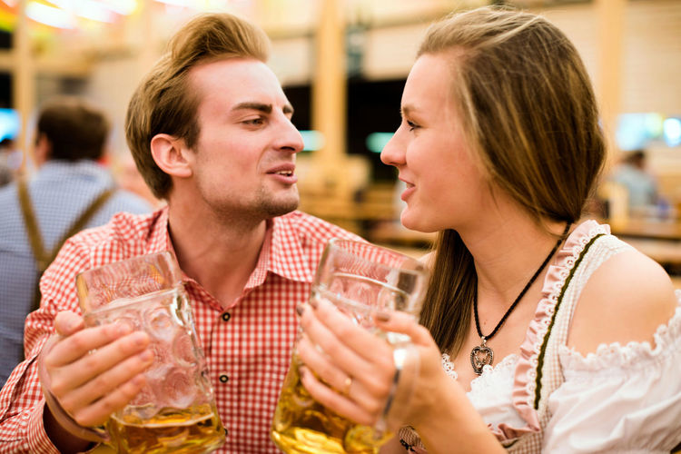 Young Couple Having Beer At Restaurant
