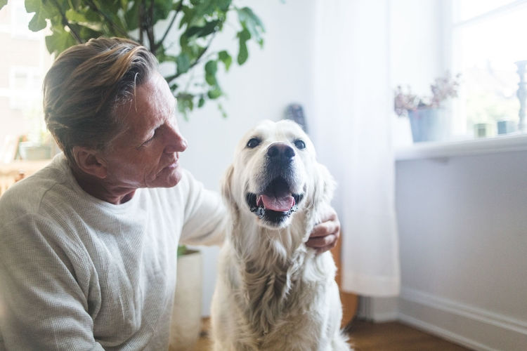 Man with dog at home