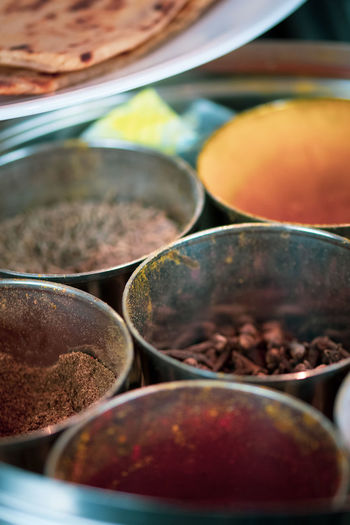 A selection of ingredients and food items at a kitchen - Indian cuisine. Food And Drink Food Selective Focus Spice Close-up Indoors  Choice Variation No People Freshness Kitchen Utensil Container Bowl Still Life In A Row Market Ingredient Day Abundance For Sale Indian Cuisine Curry
