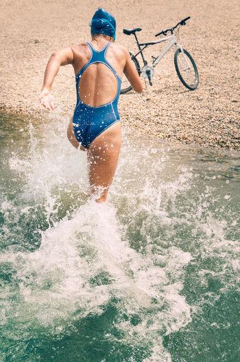 Woman running in sea