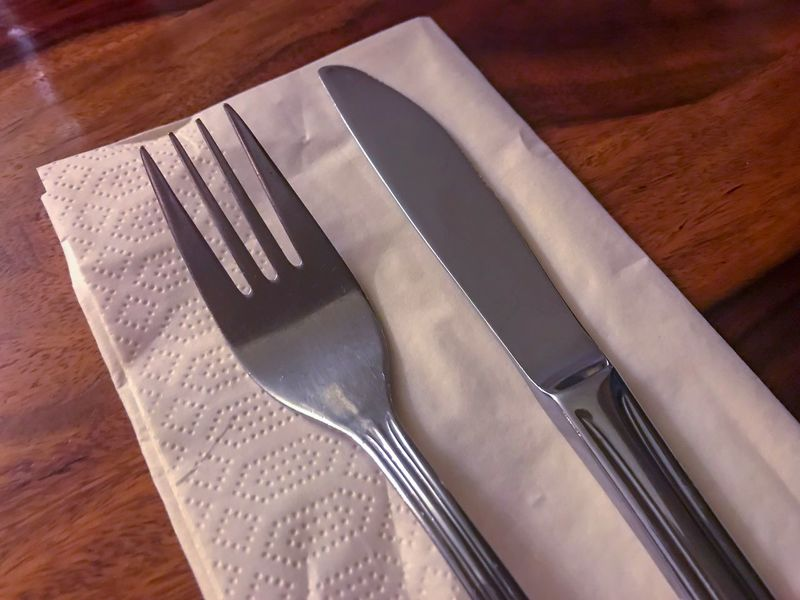 Restaurant Table Fork High Angle View Table Table Knife Cutlery No People Indoors  Plate Silver Colored Stainless Steel  Silverware  Wood - Material Close-up Food Day