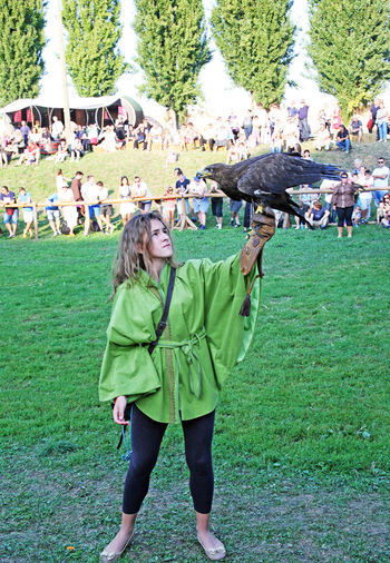 Renaissance Festival,Koprivnica 2016, 3 2016. Bird Croatia Day Eu Europe Fair Falconer Falcons Field Girl Grassy Koprivnica Lawn Outdoors Park Person Renaissance Festival Slowakia St. Bavon Standing Young