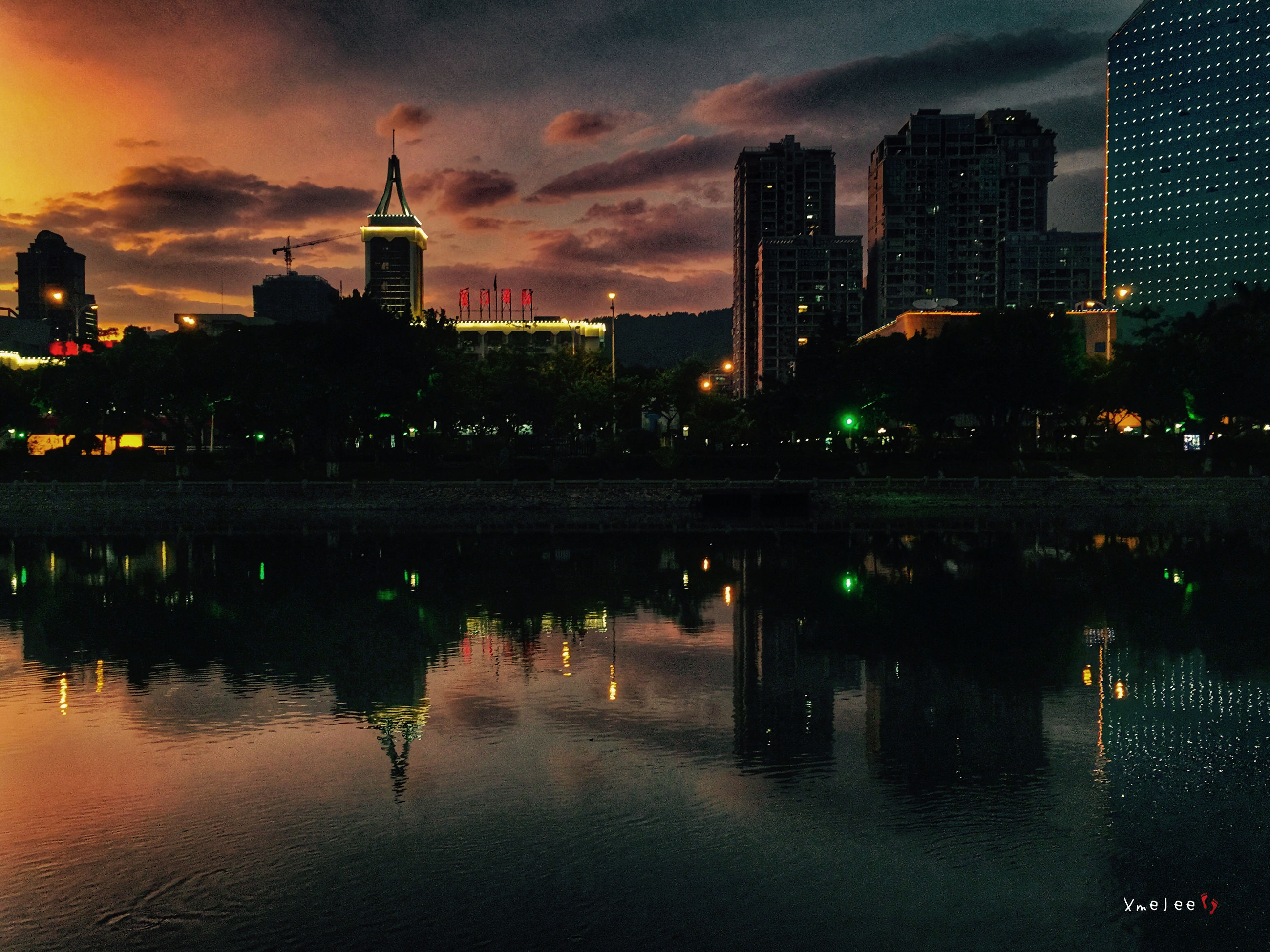 building exterior, architecture, built structure, city, water, illuminated, sky, reflection, waterfront, skyscraper, river, tower, cityscape, night, cloud - sky, sunset, tall - high, modern, urban skyline, office building