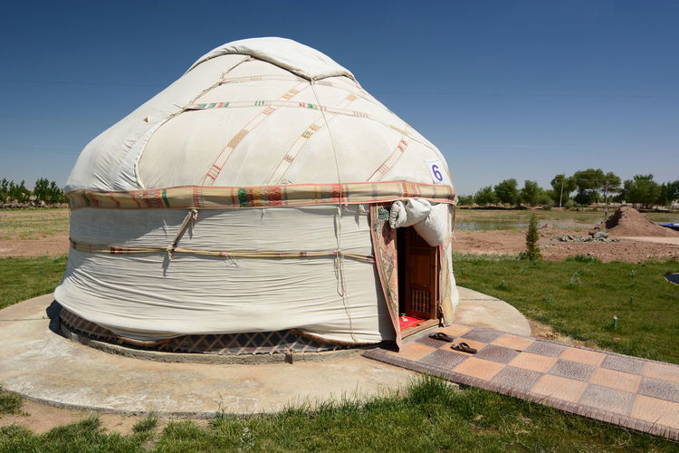 Yurta near Akchakol lake. Karalpaqstan. Uzbekistan Sunny Building Exterior Environment Shadow Blue Landscape Outdoors Built Structure Architecture No People Sunlight Nature Yurta Traditional Culture Heritage Camp Uzbekistan Karalpaqstan Desert Arid Landscape Urgench Akchakol Lake Akchakol