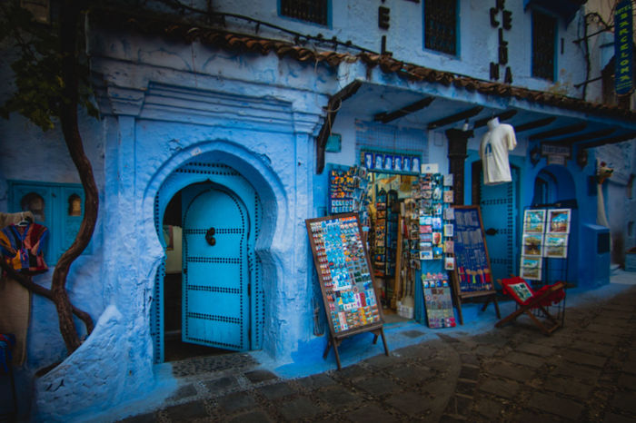 The portal Architecture Architecture Blue Building Built Structure Chefchaouen City Day Light Morocco No People Old Outdoors Porta Shop Street Tourism Travel Tree White