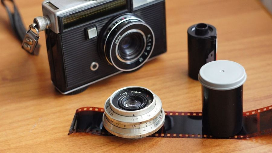 Close-up of photographic equipment on table