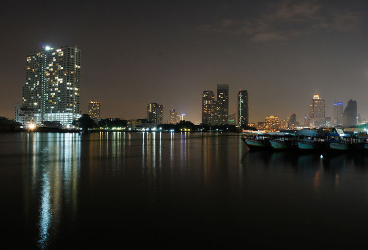 Chao Phraya river at night Architecture Asiatique The Riverfront ่Chao Phraya River City Cityscape Illuminated Night Office Building Reflection River Skyscraper Spotted In Thailand Urban Skyline Water Waterfront Envision The Future Cities At Night Battle Of The Cities