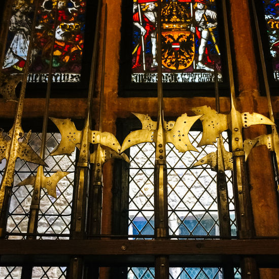 Medieval armoury in old castle, Alsace, France Alsace Armoury Built Structure Culture Cultures Decoration Hanging Historic Indoors  Large Group Of Objects Low Angle View Medieval Metal Order Ornate Stained Glass Tradition Variation Weapons Window