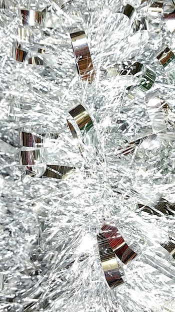 Silver And Gold Full Frame Outdoors Winter Close-up Christmas Decorations Tinsel  Macro Backgrounds Shiny Objects Shiny Things Ribbons Chrome Room For Copy Garland Shiny Decor Reflective Surface Reflections Seasonal Decoration Holiday Decorations Room For Text Holiday Shapes And Forms