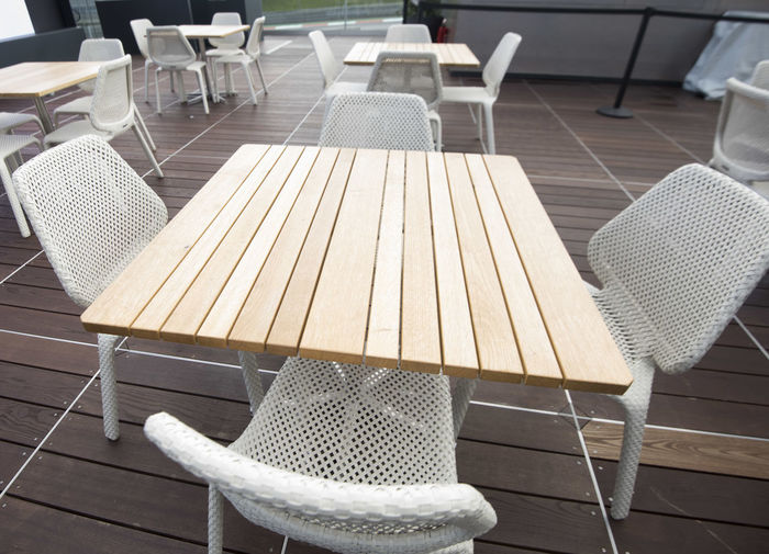 High angle view of chairs and table in restaurant