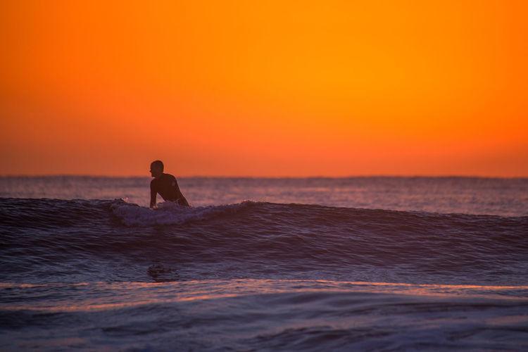 Wanda Beach Sunrise Australia Beach Cronulla Escapism Horizon Over Water Man Motion Ocean Orange Outdoors Recreational Pursuit Scenics Sea Seascape Shillouette Sky Sunrise Surf Surfer Surfing Sydney Wanda Water Wave Waves